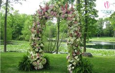 Gorgeous full floral wedding arch. Floral Designs by McNamara Florist. All Rights Reserved.