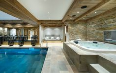 Attractive Indoor Pools Design With Indoor Swimming Pool Along Stainless Pool Ladder Also Grey Tile Floor Plus White Jacuzzi Along Grey Brick Wall As Well As Pool Homes Also New Homes With Pools, Luxury Homes With Indoor Pools Beautiful Ideas: Interior