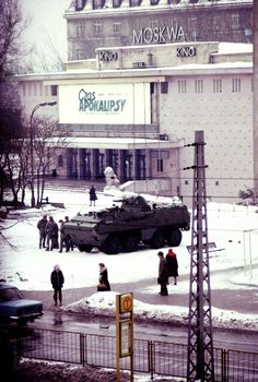 "An SKOT armoured personnel carrier stands in front of the ""Moscow"" cinema in Warsaw, with a billboard advertising the film ""Apocalypse Now"" in the background. Photograph taken by Chris Niedenthal a day after the imposition of martial law in Poland, 1 Warsaw Pact, Warsaw Poland, Apocalypse Now Movie, Europe Centrale, Poland History, Poland Travel, Famous Photos, Krakow, Eastern Europe"