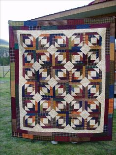 quilt made with homespun fabrics using Bonnie's pineapple quilt pattern from quiltville.com
