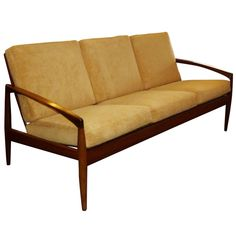 This traditional Danish Modern three-seat sofa by Kai Kristiensen features a minimal rosewood frame and new mustard-toned chenille upholstery.