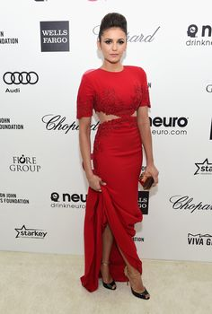 Nina Dobrev steamed up the Elton John Oscars party red carpet with a crimson cutout Reem Acra gown and metallic-accented heels.