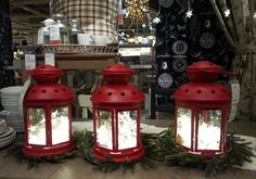 Here's a great table display, string lights inside lanterns. This would be really cute for a 4th of July party or cookout, especially late i...