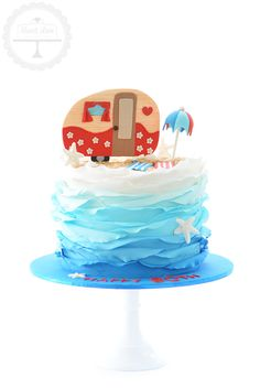 A beach themed cake for a couple celebrating their 90th birthday together. They also have a love of caravaning.