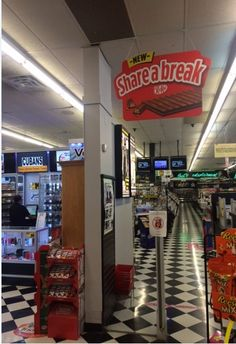 Ceiling Hangers: Not all stores will allow you to hang signs from the ceiling, but doing so can not only shout out your brand's name, but can direct shoppers to your aisle. Ceiling Hangers, Point Of Purchase, Store Signs, Hanging Signs, Creative Food, Promotion Ideas, Retail Stores, Display, Ladder