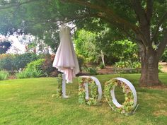 Wedding dress displayed from an old tree in the garden at Mulberry Lodge. All ready to say I Do