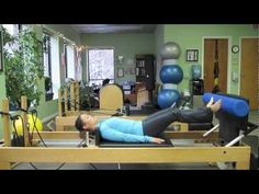 """Using a foam roller to challenge your stability during Footwork and Reverse Armwork on the Reformer. I like it!  NOTE: if during Armwork you are too challenged in keeping your ribs from """"popping,"""" put a folded towel under your head.  If your pelvis feels like it is arching your low back, put folded towels under your feet. :-)"""