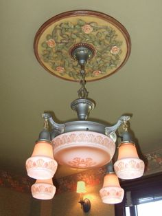 Painted Rose Medallion compliments the beautiful fixture.