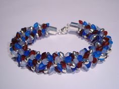 Kumihimo bracelet in shades of blue, brown and silver on Etsy, $35.00