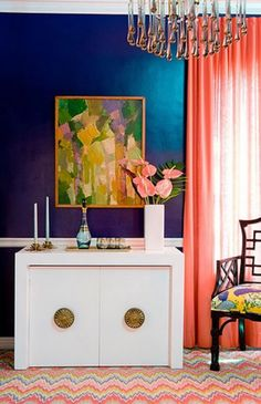 love the funky bright carpet with the navy walls and pink curtains