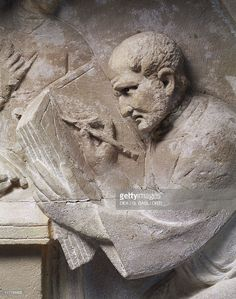 Stock Photo : Relief from mausoleum depicting tax collector, detail, man writing…