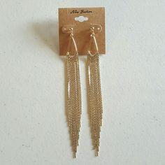 Gold Color Long Post Back Drop and Dangle Earrings Metal is color gold and earrings are post back size of earrings is 5 inches and 1 centimeter long. Jewelry Earrings