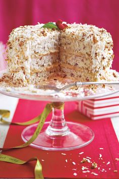 This three-layer butter cake has a pecan-pie filling in between the cake layers, a rich cream cheese frosting, and a topping of sweet coconut and chopped pecans. It's a great dessert for holiday entertaining. Cakes To Make, Pear And Almond Cake, Almond Cakes, Holiday Cakes, Christmas Desserts, Christmas Cakes, Christmas Goodies, Chocolate Roulade, Cake Recipes