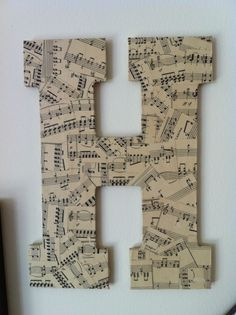 "My first venture in crafting since I joined Pinterest.  A wooden ""H"" from a craft store mod-podged with old piano music.  LOVE!"