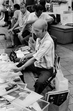 Old salesman, Singapore 2011    Nikon F5, 50mm, f/1.4  shot on AgfaPhoto APX 400 Professional     Wow! Nice pic! Learn how to blog daily - tell others - keep the money! 100% commissions! Check it out: http://michaelrochau.com
