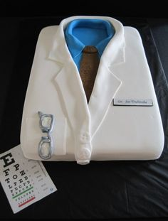 Occupation:   The father of the family is a doctor.  the cake represents his job and shows what he has has to wear to work everyday