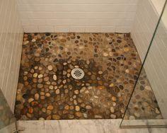 Natural river rock tile shower floor  www.mvconstruction.com