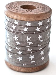 star ribbon on wooden spool