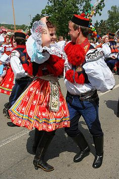 """Bohemian/Moravian Folk Costume of Kroj ~ Kroje (pronounced """"kro-yeh"""") (singular: kroj) are folk costumes worn by Czechs and Slovaks. Gothic influence is seen in tying shawls and kerchiefs on the head. In parts of Moravia, the sleeves are very full and may be tightly pleated."""