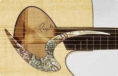 Pagelli acoustic guitar. Amazing inlay work.