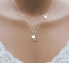 A personalized and unique design with a sterling silver sparrow charm that represents the loving and protective mother bird that hovers over her baby. A