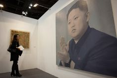 A woman looks at a portrait of North Korean leader Kim Jong Un by Chinese artist Yan Lei during the China International Gallery Exposition 2012 in Beijing, China. AP Photo/Vincent Thian.