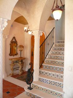 Spanish colonial entry & staircase with handmade tile risers. #staircase #stairs