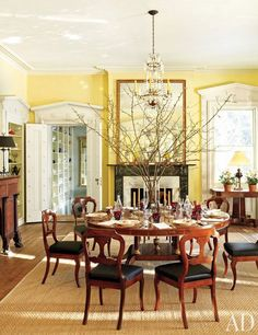 The dining room's Regency-style pedestal table, from Stair Galleries, is surrounded by circa-1840 side chairs by Duncan Phyfe and Sons; the ...