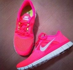 Hot pink NIKES! Actually i would probably need Adidas... that seems to be the shoe that works best with me and running