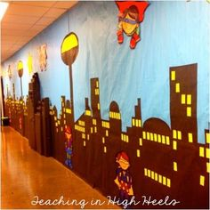Super hero wall...inspiration for a super hero theme in classroom or school library.
