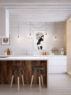 white painted brick + white cabinetry + wood grain + dip dyed stools + cage pendants