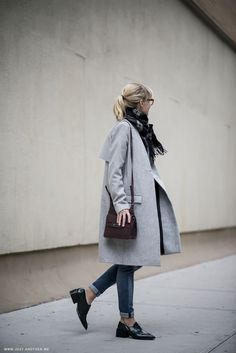 Gray coat, black shoes.