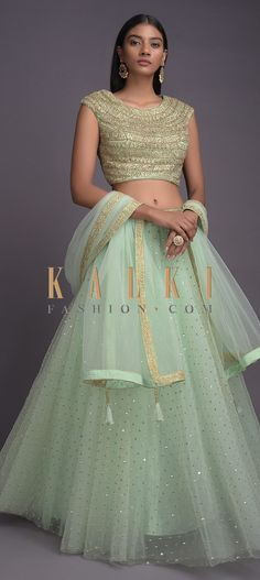 Buy Online from the link below. We ship worldwide (Free Shipping over US$100)  Click Anywhere to Tag Mint Green Lehenga And Crop Top With Embroidered Buttis Online - Kalki Fashion Mint green lehenga in net with sequins buttis and embroidered waistline.Paired with a matching crop top in net with sequins, zari, beads and kundan embroidered pattern all over.