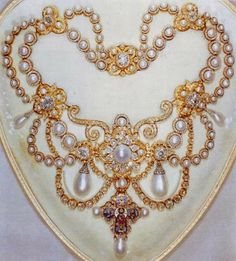 The Dagmar Necklace ~ In 1863 the Princess Alexandra of Schlewig-Holstein-Gluckburg's father was elected heir to the childless King Fredrick VII of Denmark. For the marriage to the Prince of Wales that same year, the King had a famous jeweller in Copenhagen, design a necklace in the Byzantine style. It had 118 pearls and 2000 diamonds. It is currently in the collection of the Kingdom of Great Britain.