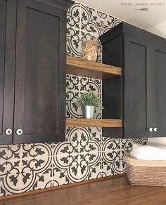 .Cement tile on the wall! Love this laundry room!