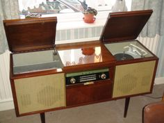 We had this exact Bush-Radiogram.  I wasn't supposed to touch it but, of course, did.  I remember Cilla Black singing Anyone Who Had a Heart on a 45 rpm vinyl single and things like the Navy Lark, The Clitheroe Kid and Two Way Family Favourites playing on the radio.