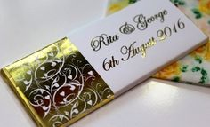 Golden luxury personalised chocolate Wedding favours.
