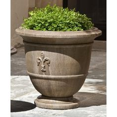 Bring quiet elegance to your garden or entryway with the Fleur de Lis Urn Planter from Campania. Crafted of cast stone and featuring a timeless urn shape with a classic fleur de lis emblem. This beautiful planter is a classic favorite. Large Garden Planters, Stone Planters, Urn Planters, Concrete Planters, Concrete Materials, Fiberglass Planters, Classic Garden, Humming Bird Feeders, Cast Stone