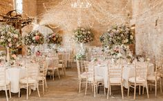 """Luxury country garden table centrepiece - Tall table arrangements - barn wedding flowers - Images by <a href=""""http://www.naomikenton.com"""" target=""""_blank"""">Naomi Kenton</a>"""