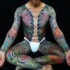 Japanese bodysuit tattoo by @horikashi.  #japaneseink #japanesetattoo #irezumi #tebori #colortattoo #colorfultattoo #cooltattoo #largetattoo #armtattoo #chesttattoo #legtattoo #bodysuit #bodysuittattoo #tattoosleeve #flowertattoo #chrysanthemumtattoo #wavetattoo #naturetattoo