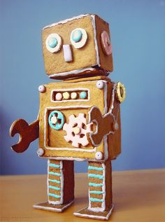 "Gingerbread robot, instead of a gingerbread house? Yes, definitely! You can find the pattern (along with a bunch of other patterns) at link below: click ""Robot"" to download PDF-pattern. Tåg=train, Djungel=djungle, Karusell=merry go round http://kampanj.milda.se/2010/#/carousel/worlds"