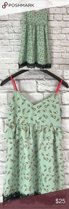 "Akira Chicago Bird Print Lace Trim Dress Akira Chicago Black Label Lace Trim Dress With Bird Print. Beautiful shade of light green with contrasting coral straps and black lace hem detail. Exposed zipper back closure and back elastic panel for a bit of stretch. Adjustable spaghetti straps. Fully lined. Item comes from smoke-free home.   Size: Small   Material: 100% Polyester   Measurements: Underarm to underarm – 15"" Total Length – 29"" (bust to hem; straps not included) AKIRA Dresses Mini"