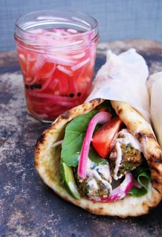 chickpea + broad bean falafels with pickled red onions + yogurt tahini sauce recipe.