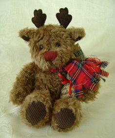"Stuffed Holiday Reindeer, Comet ""Believe in Christmas Magic."" Wearing rustic plaid tartan scarf and bag of magic pixie dust. Ages 3 and up. Non-toxic/allergenic. $21.00 w/free shipping and discounts available!"