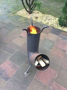 Discover thousands of images about rocket stove Rocket Stove Design, Diy Rocket Stove, Rocket Mass Heater, Rocket Stoves, Fire Pit Grill, Diy Fire Pit, Bbq Grill, Welded Metal Projects, Welding Projects