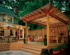 This deck cover would be awesome. Still get the light, have a place to hang a porch swing and planters without the sun burning them.