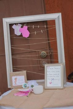 Onesies note cards in a frame. Write advise for the mommy to be or good wishes for baby girl.