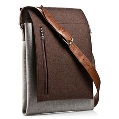 This men's merino wool messenger bag uses traditional materials like genuine felt and leather to create a contemporary work bag with a refined look. The design for this messenger bag...