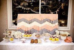 dessert table with chevron tissue backdrop