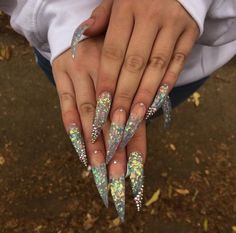 """If you're unfamiliar with nail trends and you hear the words """"coffin nails,"""" what comes to mind? It's not nails with coffins drawn on them. It's long nails with a square tip, and the look has. Bling Acrylic Nails, Aycrlic Nails, Glam Nails, Best Acrylic Nails, Bling Nails, Hair And Nails, Stiletto Nails Glitter, Pastel Nails, Perfect Nails"""